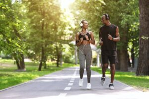 Relationship Goals. Black Couple Jogging Together In Morning Park, Enjoying Training Outdoors